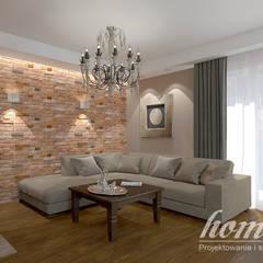 Kolonialny modern: styl , w kategorii Salon zaprojektowany przez Home Atelier