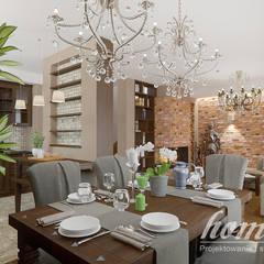 Kolonialny modern: styl , w kategorii Jadalnia zaprojektowany przez Home Atelier