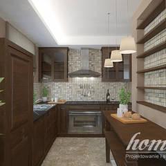 Kolonialny modern: styl , w kategorii Kuchnia zaprojektowany przez Home Atelier,