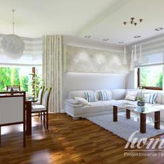 Śródziemnomorska subtelność: styl , w kategorii Salon zaprojektowany przez Home Atelier