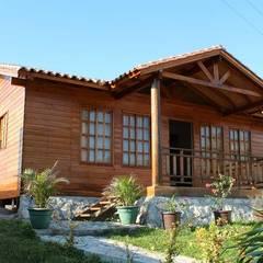 Houses by Casas y cabañas de Madera  -GRUPO CONSTRUCTOR RIO DORADO (MRD-TADPYC)