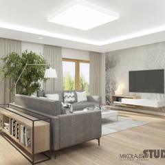 miejsce wypoczynku: styl , w kategorii Salon zaprojektowany przez MIKOŁAJSKAstudio
