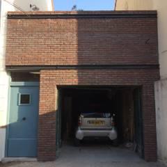 Colombes - Façade: Garage / Hangar de style  par Atelier d'architecture ASTA
