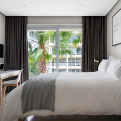 WATERFRON STAY_GULMARN APARTMENTS:  Bedroom by MINC DESIGN STUDIO