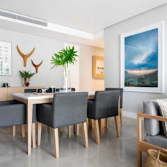 WATERFRON STAY_GULMARN APARTMENTS:  Dining room by MINC DESIGN STUDIO