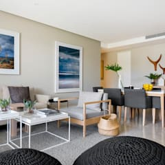 WATERFRON STAY_GULMARN APARTMENTS:  Living room by MINC DESIGN STUDIO