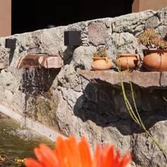 Una Casa con historia: Jardines de estilo  por Abitar arquitectura