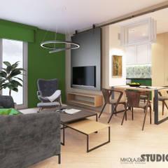 zielony salon: styl , w kategorii Salon zaprojektowany przez MIKOŁAJSKAstudio