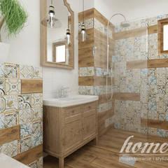 Kolonialny vintage: styl , w kategorii Łazienka zaprojektowany przez Home Atelier
