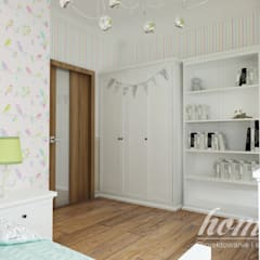 Nursery/kid's room by Home Atelier