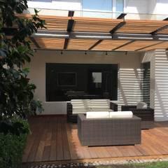 Remodelación de Terraza:  Patios & Decks by Hall Arquitectos