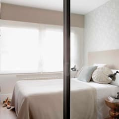 Grandes proyectos en pequeños espacios: Dormitorios de estilo  de Ivory Escapes