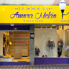 Fachada da Loja: Lojas e imóveis comerciais  por UNNA ARQUITETURA