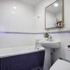恣意的享受家居生活:  浴室 by 弘悅國際室內裝修有限公司