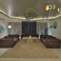 CAPITAL GREEN-2:  Living room by SPACCE INTERIORS,