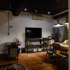 隨意放鬆小酒館的feel 根據 弘悅國際室內裝修有限公司 工業風 水泥