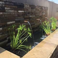 Copper spout water feature:  Garden by Acton Gardens