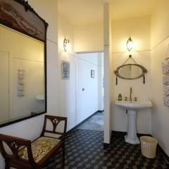 """ristorante caffetteria """"Le Jardin Fleuri - Gusti Liberty"""" - 2017: Negozi & Locali commerciali in stile  di architetto Davide Fornero"""