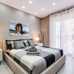 GuestHouse Baldo degli Ubaldi: Camera da letto in stile  di Luca Tranquilli - Fotografo