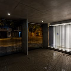Edificio Tucumán: Garajes de estilo  por Garnerone + Ramos Arq.
