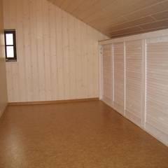 Dachbodenausbau mit Stauraum:  Wände von Parkett Kessel