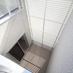 プライバシーと開放感の両立: 株式会社小木野貴光アトリエ 級建築士事務所が手掛けた庭です。