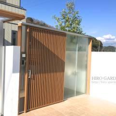 プライバシーをさりげなく: HIRO GARDENINGが手掛けた庭です。