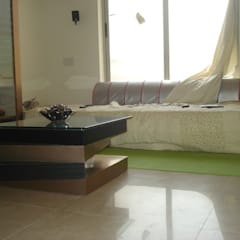 A retreat Apartment leisure room:  Media room by MRJ ASSOCIATES