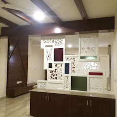 Dining Room:  Dining room by Vedasri Siddamsetty,Modern