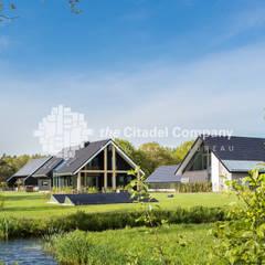 Schuurwoning boerenerf te Ommen: landelijke Huizen door Architectenbureau The Citadel Company