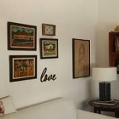 Projeto de Interiores e reforma do apartamento, Bairro Vila Rica, Santos/SP: Salas multimídia  por Maria Fernanda Antoniette