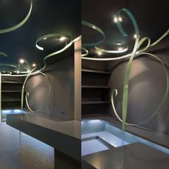 melic: Vestidores de estilo  de juan marco arquitectos