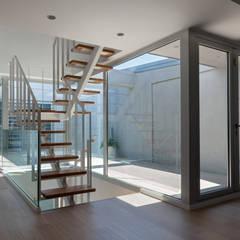 patio: Casas de estilo  de juan marco arquitectos