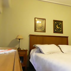 Vivienda en Olivos: Dormitorios de estilo clásico por TNArquitectura