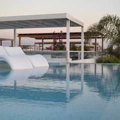 Casa de Playa NB: Piscinas de estilo  por DMS Arquitectas,
