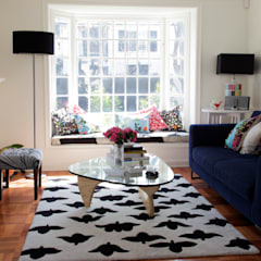 Modern living room by RENOarq Modern