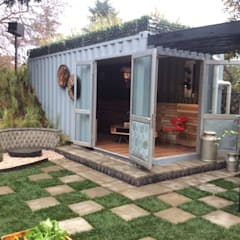 Container living with recycled materials merged into the garden:  Houses by Acton Gardens