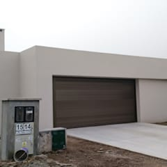 Garage Doors by ARBOL Arquitectos