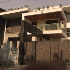 KIRTI BHAWAN:  Houses by APT Designs
