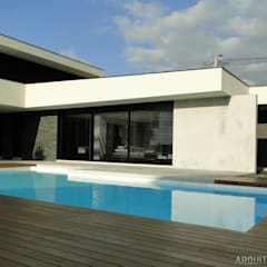 casa JL: Piscinas  por arquitetura.501