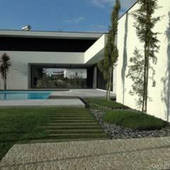 casa JL: Jardins  por arquitetura.501