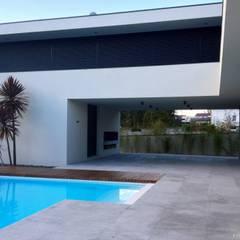 casa JL: Terraços  por arquitetura.501
