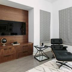 Elegante: Salas multimedia de estilo moderno por Claudia Luján