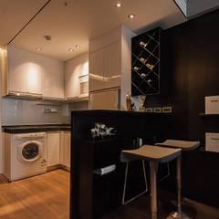 Kitchen by 沐駿室內設計有限公司