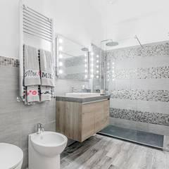 Ristrutturazione appartamento Roma, Tor Sapienza: Bagno in stile  di Facile Ristrutturare