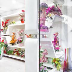 just flowers green park:  Walls & flooring by Total Interiors Solutions Pvt. ltd. ,