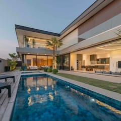 Residência Prado: Piscinas minimalistas por Padovani Arquitetos + Associados