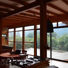 Casa Ecológica en Olmué: Livings de estilo  por Nido Arquitectos, Rústico