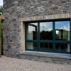 Exterior View Of Marvin's Finely Crafted Aluminium Clad Wood Casement Windows:  Wooden windows by Marvin Architectural