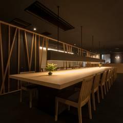 炭櫓 京都四条河原町店: ALTS DESIGN OFFICEが手掛けた一戸建て住宅です。